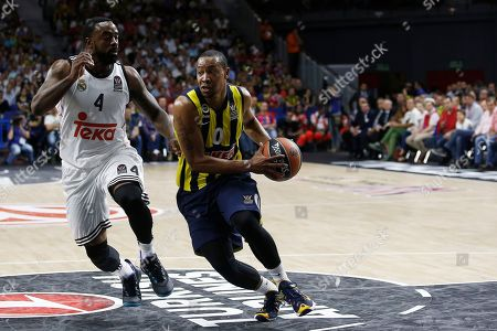 Andrew Goudelock, K. C. Rivers Fenerbahce Ulker's Andrew Goudelock, right,drives followed by Real's K. C. Rivers, left, during the Euroleague Final Four semifinal basketball match between Real Madrid and Fenerbahce Ulker in Madrid, Spain