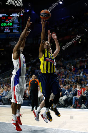 Fenerbahce's Andrew Goudelock, right, shoots the ball during the Euroleague Final Four third place basketball match between CSKA Moscow and Fenerbahce in Madrid, Spain