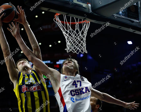 Fenerbahce's Jan Vesely goes for the ball with CSKA's Andrei Kirilenko during the Euroleague Final Four third place basketball match between CSKA Moscow and Fenerbahce in Madrid, Spain