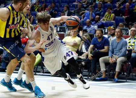 Stock Photo of CSKA's Andrei Kirilenko, right, drives the ball past Fenerbahce's Luka Zoric, left, during the Euroleague Final Four third place basketball match between CSKA Moscow and Fenerbahce in Madrid, Spain