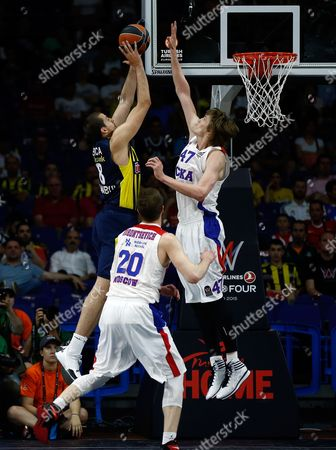CSKA's Andrei Kirilenko, right, blocks a shot by Fenerbahce's Namanja Bjelica during the Euroleague Final Four third place basketball match between CSKA Moscow and Fenerbahce in Madrid, Spain