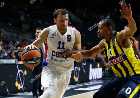 CSKA's Manuchar Markoishvili, left, drives the ball around Fenerbahce's Andrew Goudelock during the Euroleague Final Four third place basketball match between CSKA Moscow and Fenerbahce in Madrid, Spain