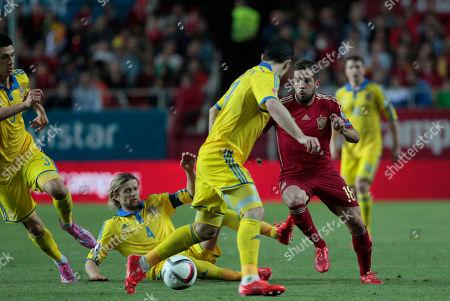 Jordi Alba, Anatoliy Tymoshchuk Spain's Jordi Alba fights for the ball against Ukraine's Anatoliy Tymoshchuk during the Euro 2016 qualifying soccer match between Spain and Ukraine, at the Ramon Sanchez Pizjuan stadium, in Seville, Spain, on