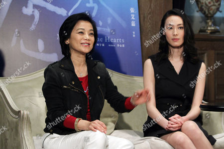 """Sylvia Chang, Isabella Leong Taiwanese director Sylvia Chang, left, and Macanese actress Isabella Leong speak during an exclusive interview with The Associated Press for their latest movie """"Murmur of the Hearts"""" in Taipei, Taiwan, . The film premiers in Taiwan on April 10"""