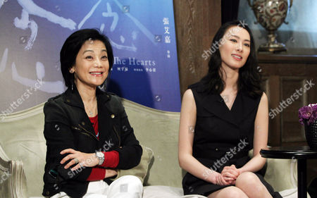 """Sylvia Chang, Isabella Leong Taiwanese director Sylvia Chang, left, and Macanese actress Isabella Leong speak during an interview with The Associated Press for their latest movie """"Murmur of the Hearts"""" in Taipei, Taiwan, . The film premiers in Taiwan on April 10"""