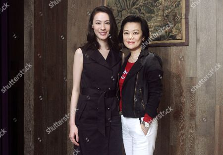 """Sylvia Chang, Isabella Leong Taiwanese director Sylvia Chang, left, and Macanese actress Isabella Leong smile as they pose for photos during an exclusive interview with The Associated Press for their latest movie """"Murmur of the Hearts"""" in Taipei, Taiwan. Chang is making a comeback after a seven-year hiatus with """"Murmur of the Hearts,"""" which pairs seasoned actors with fresh faces to tell a story about three young people with a broken past struggling with finding compassion in their relationships"""