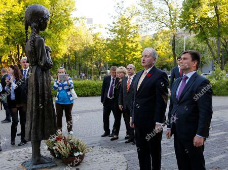 Pavlo Klimkin, Rob Nicholson Ukrainian Foreign Minister, Pavlo Klimkin and Canada's Foreign Minister Rob Nicholson lays flowers at a monument to honour victims of the Great Famine in Kiev, Ukraine