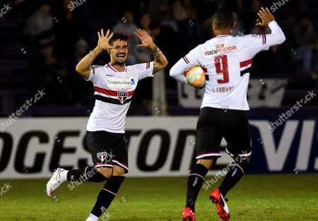 Alexandre Pato, Luis Fabiano Alexandre Pato of Brazil's Sao Paulo FC, left, celebrates with teammate Luis Fabiano after scoring against Uruguay's Danubio during a Copa Libertadores soccer game in Montevideo, Uruguay
