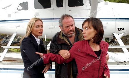 'Emmerdale'  TV - 2005 -  Zoe Tate (Leah Bracknell)  is shocked when Sadie King (Patsy Kensit) steps off the sea plane instead of Effie. Sadie has an offer Zoe simply can't refuse. Also pictured John Widnes (David Fleeshman).