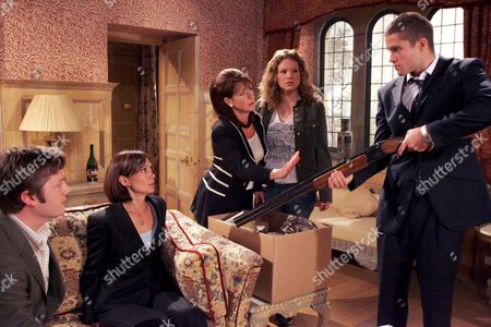'Emmerdale'  TV - 2005 -  Scott Windsor (Ben Freeman) loses it after Zoe Tate (Leah Bracknell) is found innocent by the court and decides to try and take Jean with him. Viv Hope (Deena Payne) tries to make him see sense. Also pictured Callum Rennie (Andrew Whipp) and Dawn Woods (Julia Mallam).