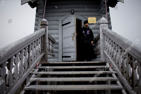 38-year-old Russian Orthodox priest Sophrony Kirilov walks out from the Holy Trinity Church, located on top of a rocky hill on King George Island, Antarctica. Kirilov, 38, helps with carpentry and other manual jobs on the weekdays at Russia's Bellinghausen base on the island, and officiates Mass at the world's southernmost Eastern Orthodox church on the weekends