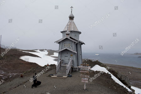 Russian Orthodox priest Sophrony Kirilov, 38, walks to the Holy Trinity Church, precariously perched on a rocky hill on King George Island, Antarctica. Russian priests here rotate in for yearlong stints, primarily to celebrate Mass for the workers on the Russian Bellinghausen base, which number between 15 and 30 people at a time