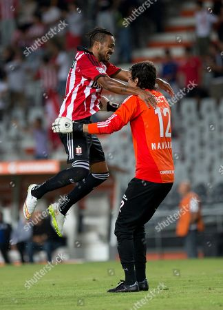 Stock Photo of Alvaro Pereira, left, and Hilario Navarro of Argentina's Estudiantes celebrate after teammate Guido Carrillo scored against Ecuador's Independiente del Valle at a Copa Libertadores soccer match in La Plata, Argentina