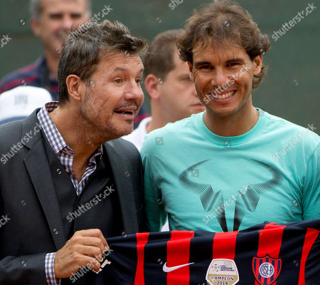 Spain's tennis player Rafael Nadal, right, stands with Argentina's media personality Marcelo Tinelli as he poses for photos during an event with youth in Buenos Aires, Argentina, . Nadal is in Argentina for the Argentina Open