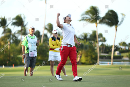 Sei Young Kim, Sun Young Yoo Second place finisher Sun Young Yoo of South Korea, background in yellow, watches Sei Young Kim of South Korea, pump her fist in the air after winning the Pure Silk Bahamas LPGA Classic at the Ocean Club Golf Course, Paradise Island, Bahamas