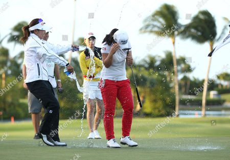Sei Young Kim, Jenny Shin, Sun Young Yoo Jenny Shin of South Korea drenches Sei Young Kim of South Korea with water after Kim won the Pure Silk Bahamas LPGA Classic at the Ocean Club Golf Course, Paradise Island, Bahamas, . Second place finisher Sun Young Yoo of South Korea is pictured in the background in yellow