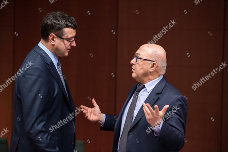 Michel Sapin, Janis Reirs France's Finance Minister Michel Sapin, right, speaks with Latvian Finance Minister Janis Reirs during a meeting of Eurogroup finance ministers at the EU Council building in Brussels on . Greece's radical left government and its European creditors headed into new talks Monday on the debt-heavy country's stuttering bailout program, but expectations are low despite a fast-approaching deadline for some kind of deal