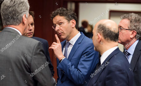 Pierre Moscovici, Wolfgang Schaeuble Dutch Finance Minister Jeroen Dijsselbloem, center, speaks with Austrian Finance Minister Hans Jorg Schelling, left, during a round table meeting of eurogroup finance ministers in Brussels on . Eurozone finance ministers meet for a crucial day of talks Friday to see whether a Greek debt relief proposal is acceptable to Germany and other nations using the common currency
