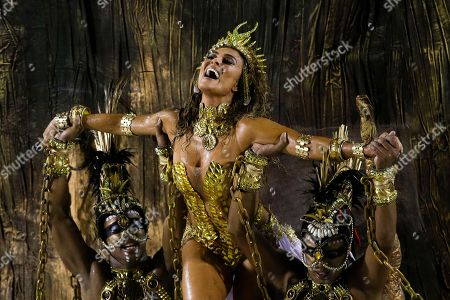 Juliana Paes Actress Juliana Paes is carried by dancers of the Viradouro samba school in the Carnival parade at the Sambadrome in Rio de Janeiro, Brazil, . The skies opened up about an hour ahead of the start of the all-night-long extravaganza, drenching revelers and flooding streets near the Sambadrome
