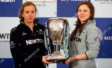 Stock Picture of Oxford women's boat race captain Anastasia Chitty, left, and Cambridge captain Caroline Reid, right, pose with the trophy at a media opportunity in London, . The 161st boat race between Oxford and Cambridge University crews will take place on April 11, on the River Thames. The women's team will race on the same day and on the same course as the men's team for the first time this year