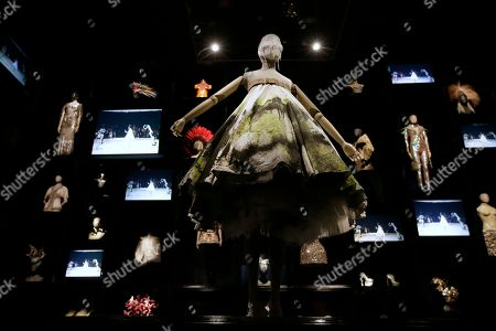 A dress worn by model Shalom Harlow, who became became a human canvas at Alexander McQueen's 13th fashion show in September 1998, as robotic arms spray painted her tulle dress, which is one of the major items on display at the Alexander McQueen exhibition 'Savage Beauty' at the Victoria and Albert museum in London, Thursday, March, 12, 2015