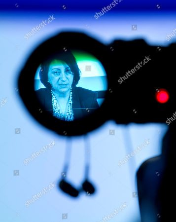 Dr. Androulla Johnstone, seen through a TV camera eyepiece, the lead investigator for the Investigation into the Association of Jimmy Savile with the Stoke Manderville Hospital report, speaks at a press conference in London to announce the reports findings, . A new report into widespread sex abuse by the late BBC entertainer Jimmy Savile has found that victims' complaints about his activities were ignored. The report released Thursday showed an extensive pattern of abuse at numerous National Health Service hospitals where the celebrity broadcaster was given wide access to patients even though he was known by some staff to be a sexual predator