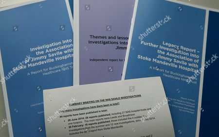 A view of the main reports for the Investigation into the Association of Jimmy Savile with Stoke Manderville Hospital at a press conference in London to announce the reports findings, . A new report into widespread sex abuse by the late BBC entertainer Jimmy Savile has found that victims' complaints about his activities were ignored. The report released Thursday showed an extensive pattern of abuse at numerous National Health Service hospitals where the celebrity broadcaster was given wide access to patients even though he was known by some staff to be a sexual predator