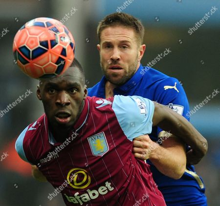 Aston Villa's Christian Benteke contests the ball with Leicester's Matthew Upson, left, during the FA Cup fifth round soccer match between Aston Villa and Leicester City at Villa Park, Birmingham, England