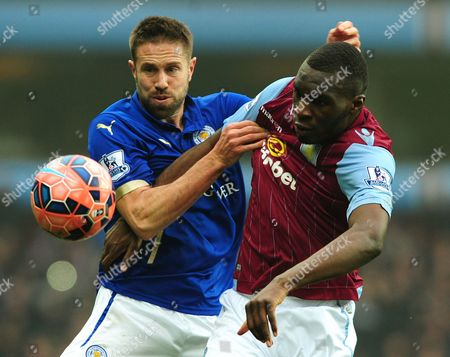 Aston Villa's Christian Benteke, right, contests the ball with Leicester's Matthew Upson during the FA Cup fifth round soccer match between Aston Villa and Leicester City at Villa Park, Birmingham, England