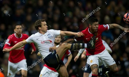Preston's Kevin Davies, left, fights for the ball against Manchester United's Marcos Rojo during the English FA Cup Fifth Round soccer match between Preston and Manchester United at Deepdale Stadium in Preston, England