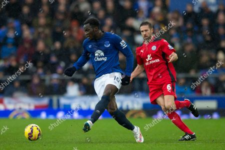 Everton's Romelu Lukaku, left, takes the ball past Leicester's Matthew Upson during the English Premier League soccer match between Everton and Leicester at Goodison Park Stadium, Liverpool, England