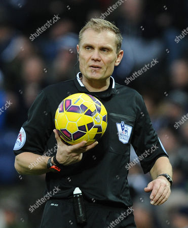 Referee Phil Dowd with the ball during the English Premier League soccer match between West Bromwich Albion and Southampton at the Hawthorns, West Bromwich, England