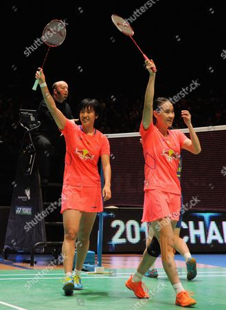 China's Bao Yixin and Tang Yuanting, right, celebrate after beating China's Wang Xiaoli and Yu Yang 21-14, 21-14 during the Women's Doubles final, at the All England Badminton Championships in Birmingham, England