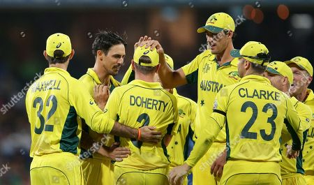 Stock Image of Xavier Doherty Australia's Xavier Doherty, third left, celebrates after he took a catch to dismiss Sri Lanka's Thisara Perera during their Cricket World Cup Pool A match in Sydney, Australia