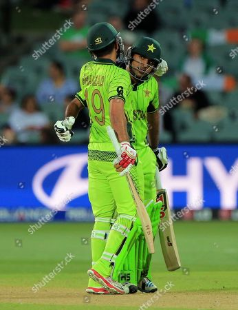 Sarfraz Ahmed, Ahmed Shahzad Pakistan's Sarfraz Ahmed, right is congratulated by teammate Ahmed Shahzad, for his fifty runs during their Cricket World Cup Pool B match against Ireland in Adelaide, Australia