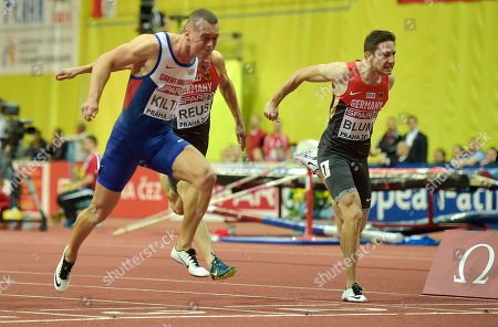 Britain's Richard Kilty, left, crosses the line ahead of second placed Germany's Christian Blum, right, in the men's 60m final at the European Athletics Indoor Championships in Prague, Czech Republic
