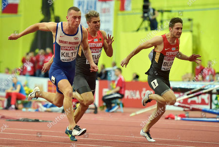Britain's gold medal winner Richard Kilty crosses the line ahead of third placed Germany's Julian Reus and second placed Germany's Christian Blum, from left, in the men's 60m final at the European Athletics Indoor Championships in Prague, Czech Republic