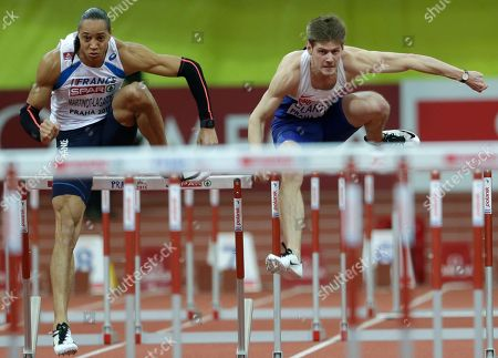 France's Pascal Martinot-Lagarde, left, and Britain's Lawrence Clarke clear a hurdle in a men's 60m hurdles first round heat at the European Athletics Indoor Championships in Prague, Czech Republic
