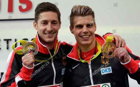 Stock Image of Christian Blum, Julian Reus Germany's Christian Blum, left, celebrates silver medal with bronze medalist Germany's Julian Reus, following the 60m race at the European Athletics Indoor Championships in Prague, Czech Republic