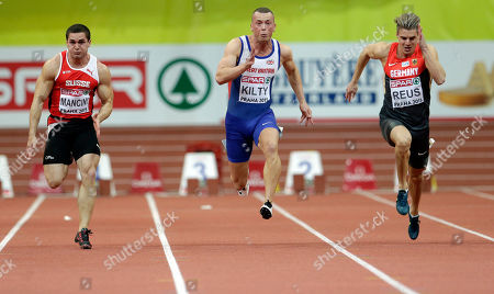 Richard Kilty, Pascal Mancini, Christian Blum Britain's Richard Kilty, center, runs to win the 60m race between fifth placed Switzerland's Pascal Mancini, left and second placed Germany's Christian Blum, at the European Athletics Indoor Championships in Prague, Czech Republic