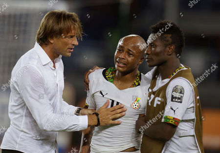 Ivory Coast's head coach Herve Renard, left, consoles Ghana's Andre Ayew, center, and Asamoah Gyan, right, after Ghana lost their African Cup of Nations final soccer match to Ivory Coast in Bata, Equatorial Guinea