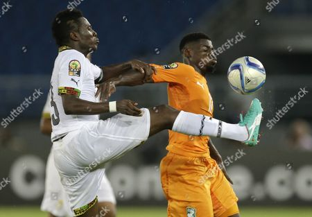 Ghana's Asamoah Gyan, left, vies a ball against Ivory Coast's Serge Aurier, right, during their African Cup of Nations final soccer match in Bata, Equatorial Guinea