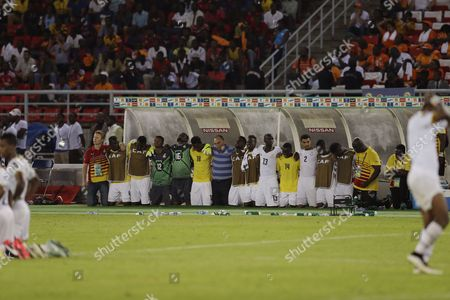 Ghana's head coach Avram Grant, center, with his players watch their penalty shoot out for African Cup of Nations final soccer match against Ivory Coast in Bata, Equatorial Guinea