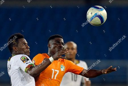 Asamoah Gyan, Serge Aurier Ghana's Asamoah Gyan, left, challenges Ivory Coast's Serge Aurier, right, during their African Cup of Nations final soccer match in Bata, Equatorial Guinea
