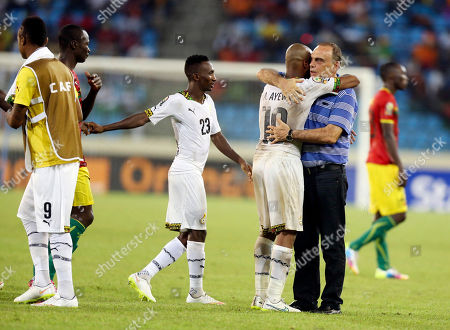 Ghana's head coach Avram Grant, right, congratulates Ghana's captain Andre Ayew, after their African Cup of Nations quarter final soccer match with Guinea at the Estadio De Malabo, Equatorial Guinea
