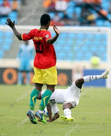 Ghana's Harrison Afful, below, is tackled by Guinea's Kevin Constant during their African Cup of Nations quarter final soccer match at the Estadio De Malabo, Equatorial Guinea