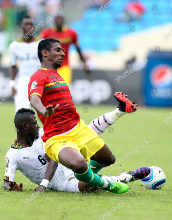 Ghana's Afriyie Acquah, left, is tackled Guinea's Kevin Constant during their African Cup of Nations quarter final soccer match at the Estadio De Malabo, Equatorial Guinea