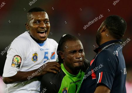 Democratic Republic of Congo's goalkeeper Robert Muteba Kidiaba, center, is emotional as teammate Nelson Munganga Omba, left, celebrates after winning their African Cup of Nations quarter final soccer match against Congo in Bata, Equatorial Guinea