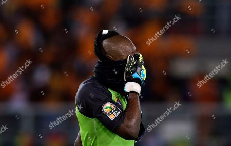 A dejected Congo's goalkeeper Robert Muteba Kidiaba leaves the field after being knocked out of African Cup of Nations semifinal soccer match by Ivory Cost in Bata, Equatorial Guinea