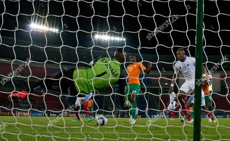 Ivory Coast's Wilfried Serge Kanon, center, shoots a goal against Congo's goalkeeper Robert Muteba Kidiaba, foreground, during their African Cup of Nations semifinal soccer match in Bata, Equatorial Guinea